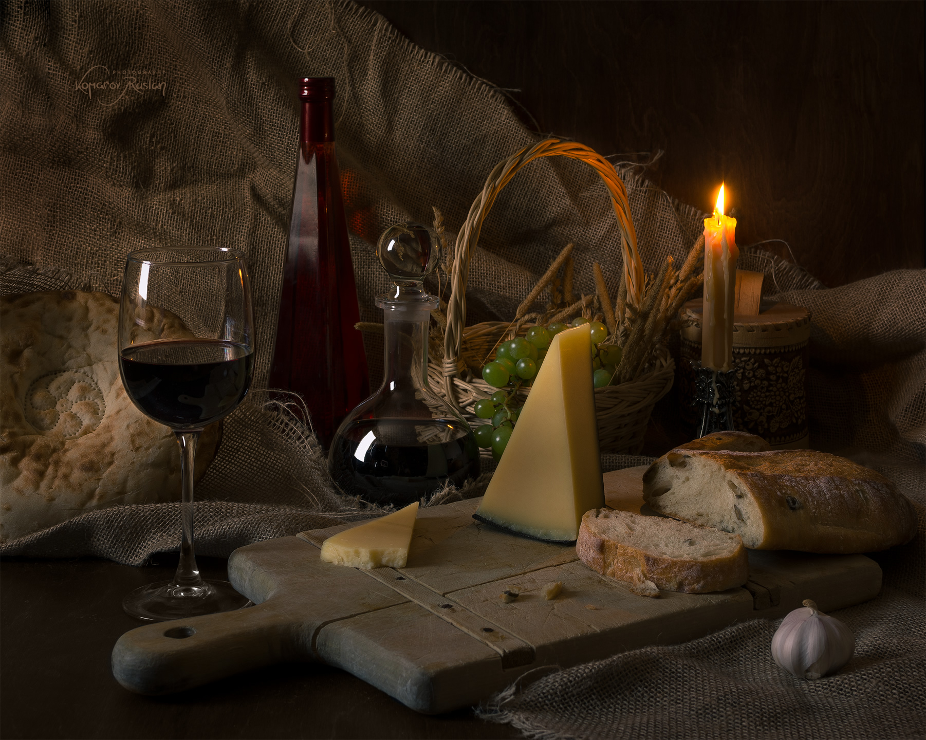 Candle Candlelight Extravagant Lavish Dining Table Tablecloth Still Life Wine Cheese Bread Natural Light Darkbackground Rustic Glass